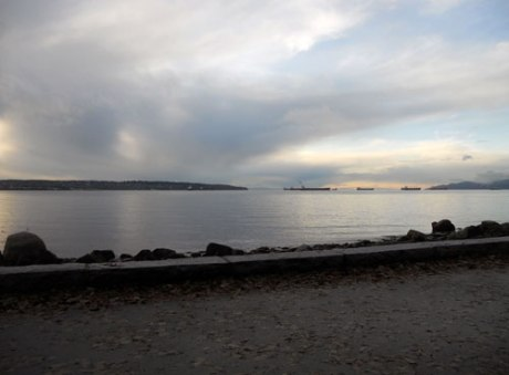 Late afternoon light plays with clouds and reflections on English Bay.