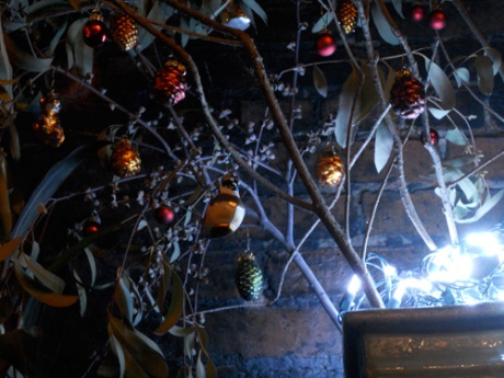 Our little branches  and glass ornaments illuminated in blue-whit light.