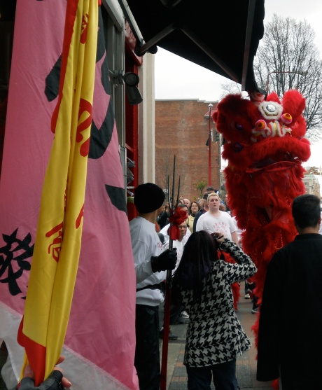 As well as his attendants, a huge crowd of onlookers follow the lions through the streets of Chinatown, all to the sound of beating drums and firecrackers popping!