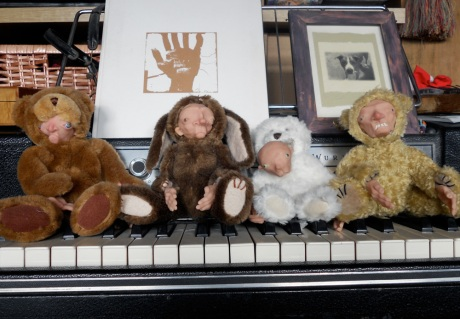 GJ's Teds displayed on the piano.