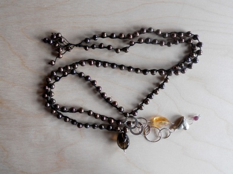 Rich dark brown pearls with semi precious stones, silver chain and a heart pendant by GJ Pearson.