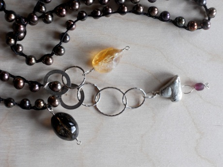 I love the hearts GJ cast a few years ago in lead-free pewter. I wear one just on a simple cord.