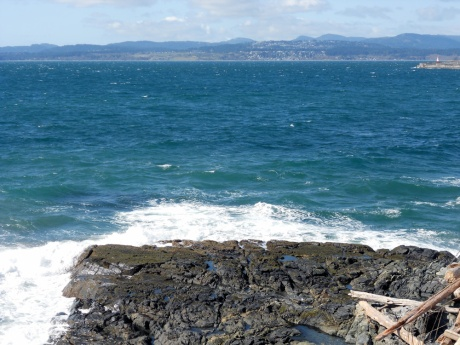 Big waves and the water was a magnificent colour. A tiny bot of Ogden Point and the Sooke Hills in the background.