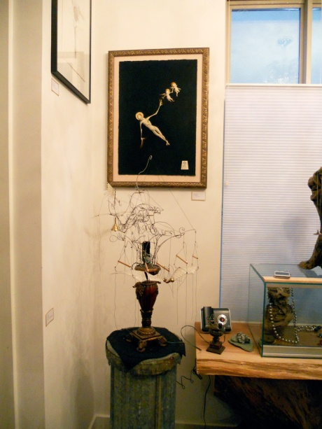 "GJ's ""Little Sister"" sculpture among some of his paintings and drawings."
