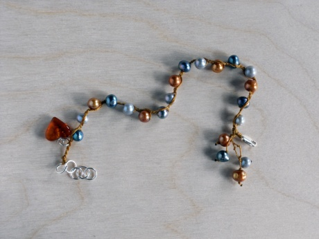 Bracelet of grey, silver and gold pearls with Baltic amber heart. Firehorse Designs, Victoria BC