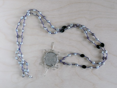 Wire-wrapped Canadian 1957 coin by GJ Pearson with silvery pearls, onyx and lepedolite. © Firehorse Designs 2013