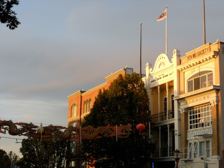 Warm August sunset illuminating buildings in Chinatown, Victoria BC.