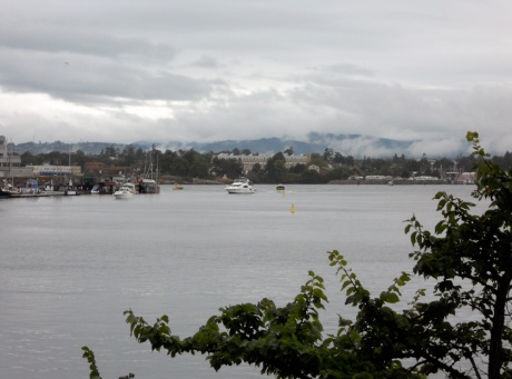 Looking out toward the entrance to the Inner Harbour with the clouds hanging out over the hills of Sooke and Metchosin beyond.