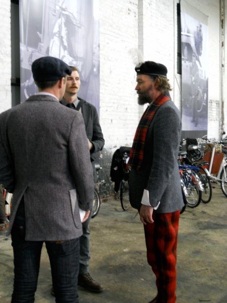 GJ (right), in his fabulous hunting trousers,  beret and Welsh wool tweed jacket, chats with two other tweedy gents.