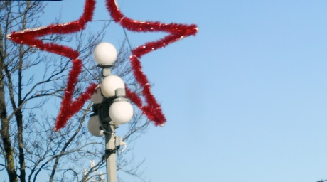 All the downtown streets have jolly decorations of delight.