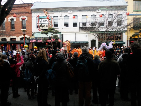 Participants and spectators taking part on the Lunar New Year Lion Dance, Chinatown Victoria BC.