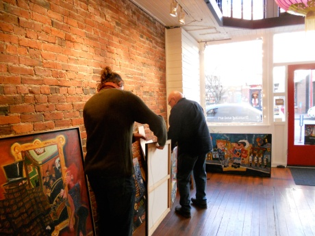 Hanging day: Michael and GJ deciding where each piece will be.
