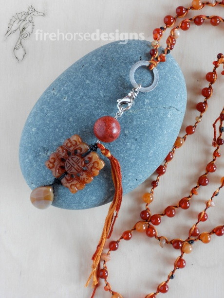 Carnelian, brown jade and silver.
