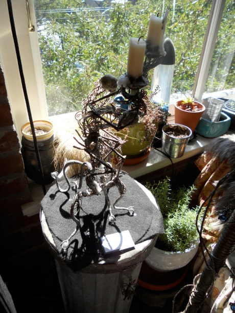 GJ's skeleton candlesticks stand guard over the herb pots.
