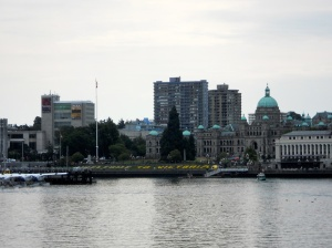 A view of the Inner Harbour from a different direction. The Welcome to Victoria sign built from yellow flowers is quite visible even from this distance.