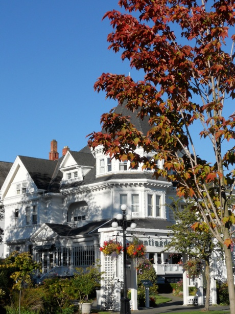 Beginnings of autumn colour at The Gatsby Mansion, built originally as a home for the Pendray family, circa 1890; Victoria BC Canada.