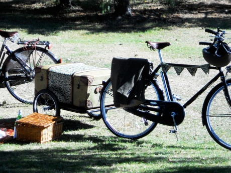 Beautiful bicycles, picnic hampers and trailers.