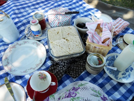 My picnic: tea sandwiches, cream scones with strawberry jam and clotted cream, lemon cake and plums.