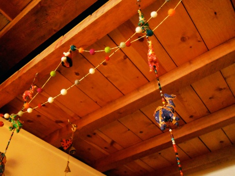 Little felted wool balls strung to make colourful garlands, along with camels from India and my favourite glass fox.